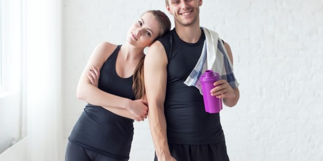Fit couple rest after exercising